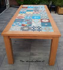 Red American oak, outdoor table, with a Portugese tiled tabletop. made by  http