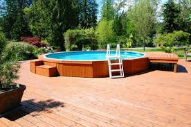 Image Oval Above Ground Pool The Spruce Aboveground Swimming Pools Designs Shapes And Sizes