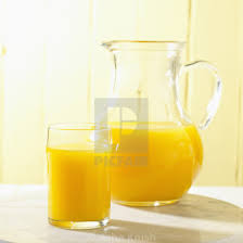 glass and pitcher of orange juice stock image
