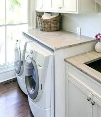 diy countertop over washer and dryer laundry room laundry room over washer dryer laundry room s diy countertop over washer and dryer