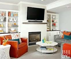tv over fireplace grey and orange living room with large mounted on wall tv fireplace mount tv over fireplace