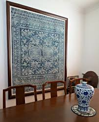 a framed piece of antique cloth displayed with some blue and white pottery at the on antique cloth wall art with creativity my own chinese brocade