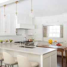 white shaker cabinets with light gray quartzite countertops