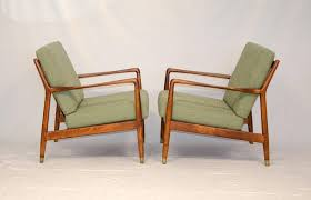 pair of swedish lounge chairs folke ohlsson for dux at 1stdibs
