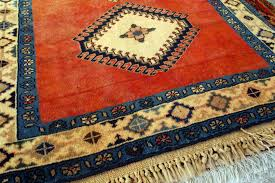 your rugs may be hand knotted with natural foundation yarns as opposed to separate synthetic backing fabrics for tufted carpet