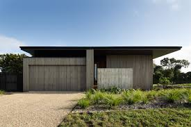 Small Picture House Under Eaves by MRTN Architects in Point Wells New Zealand