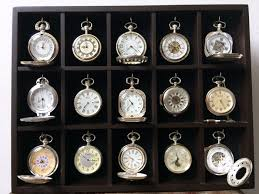 collection of 15 silver plated mechanical pocket watches in a luxury display case