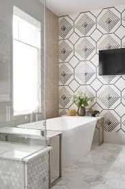 freestanding bathtub on large marble hex floor tiles