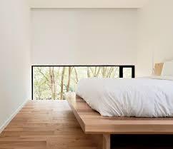 Bedroom, Bed, And Medium Hardwood Floor The Low Windows In The Master  Bedroom Focus