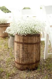 Fill an old wine barrel with baby's breath for decorating a rustic or  vintage wedding.