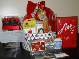 this basket of romance contains candy roses tickets and restaurant gift certificates applebees chili s jewelry a candle and more for you and