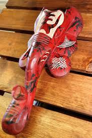 elephant mask red wood with ara symbol