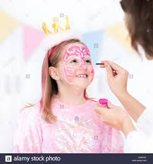 face painting for little girl princess and fairy theme birthday party with face paint artist and costume for preschool child kids celebrating hallow