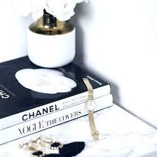 chanel coffee table book coffee table book jewels statement earrings earrings watch gold watch book coffee chanel coffee table book