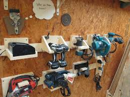 i was using a cabinet up to this point but i m not a huge fan of cabinet storage so when i first saw this thing called french cleat system in family