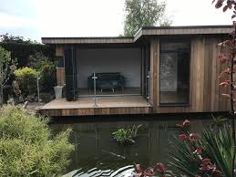 home office in the garden. The Garden Before Work Started Building Appears To Float Over Water Home Office In G