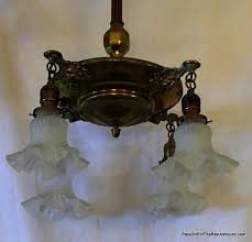 this late victorian 4 light brass ceiling fixture was manufactured approximately 1890 1900 this art nouveau hanging brass ceiling fixture has four ornately