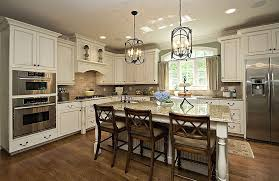 traditional kitchen with breakfast bar restoration hardware 18th c arched maison lantern pendant