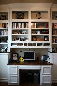 built in bookshelves with built in desk that protrudes out a bit for phase