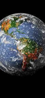 Earth, water splash, black background ...
