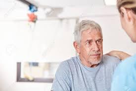 Geriatric Nursing Senior Patient Is Comforted By Geriatric Nurse In Rehab Or Nursing