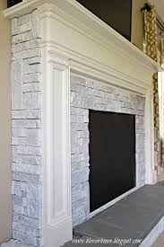 white painted airstone faux fireplace blesser house featured on remodelaholic
