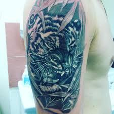 что означает тату тигра на плече девушек значение татуировки тигра