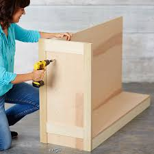 secure the end panel to the base assembly