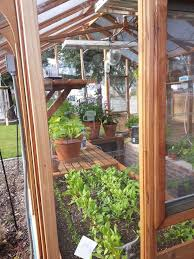 a good greenhouse structure must handle wind rain and snow and allow for benches shelves hanging baskets light fixtures and other accessories