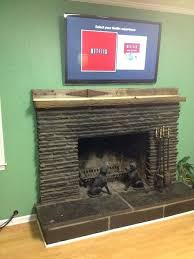 how to hide cords on wall mounted tv above fireplace