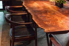 live wood edge table and mid century modern chair saison the next