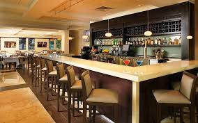 interior polished concrete flooring white covered floor basement bar ideas l shape brown leather sofa red