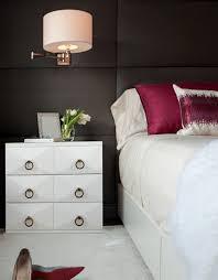 bedside sconce lighting. Bedside Sconces Brass Lighting Stylish Design Table Drawer Red Pillows Flowers In Vase Sconce I