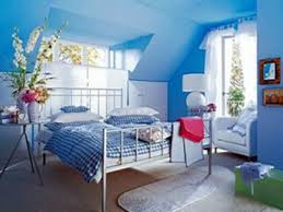cheerful light blue teenage girls bedroom interior design with light blue wall paint colors and plaid bedding also beautiful orchid flower