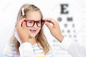 Child Eye Test Chart Child At Eye Sight Test Little Kid Selecting Glasses At Optician