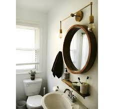 bathroom sconce lighting modern. Brass Sconce Over Round Mirror Bathroom Lighting Modern