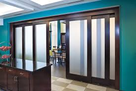 telescoping door systems smoothly retract and extend multiple door panels moving in the same direction