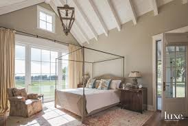 a custom rug from matt camron rugs tapestries grounds the master bedroom which features