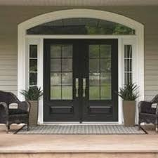 painted double front door. Painted Front Door. White Trim. Planters In Of Side Panels. Chairs Next Double Door
