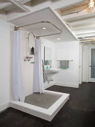 concrete floor in awesome inexpensive bathroom remodeling ideas design with curtain shower rod and open shower also basement ceiling