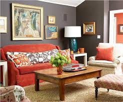grey wall paint color for living room with red sofa and wooden table decoration also large wall decor ideas