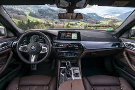 2018 bmw 5 series interior. brilliant interior the m550i we tested was mediterranean blue metallic with a mocha nappa  leather interior bmw m performance changes over standard 5 series  throughout 2018 bmw series interior