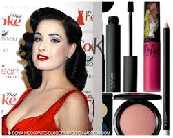 von teese works a red lip in a far more striking manner than bryant the results dita von teese to launch new makeup line