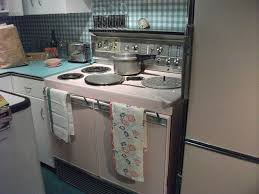 stove and refrigerator set. a wonderful vintage pink stove and refrigeratorset against great turquoise refrigerator