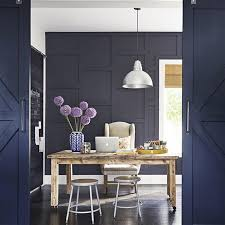 navy blue barn doors add privacy to this home office from magazine the linkinbio to see the whole house