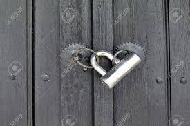 modern door texture. Modern Padlock On Textured Black Wooden Door. Background And Texture For Text Or Image Stock Door W