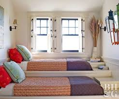 Even the most awkward spaces can fit a shared bedroom, and this staircase  platform is proof. Similar to a trundle bed, one person sleeps slightly  above the ...