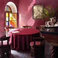 maroon tablecloth for round table closed unique chair on floor in moroccan dining room with nice picture on wall near green palm tree