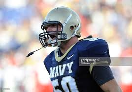 Linebacker Tony Haberer of the Navy Midshipmen cheers a defensive ...