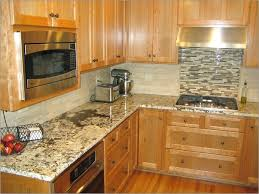 glass tile ideas for granite countertop and backsplash with oak cabinets